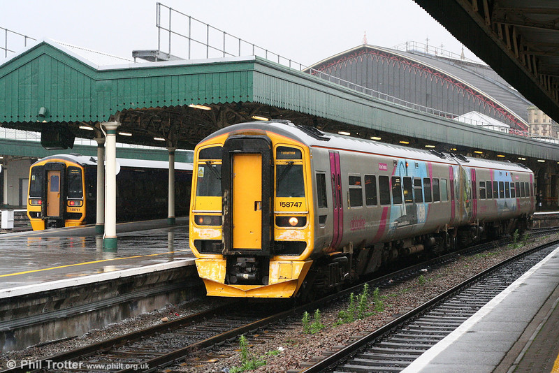 FGW 158747 in advertising livery at Bristol Temple Meads forming the 0951 Great Malvern to Taunton on 8th December 2007.