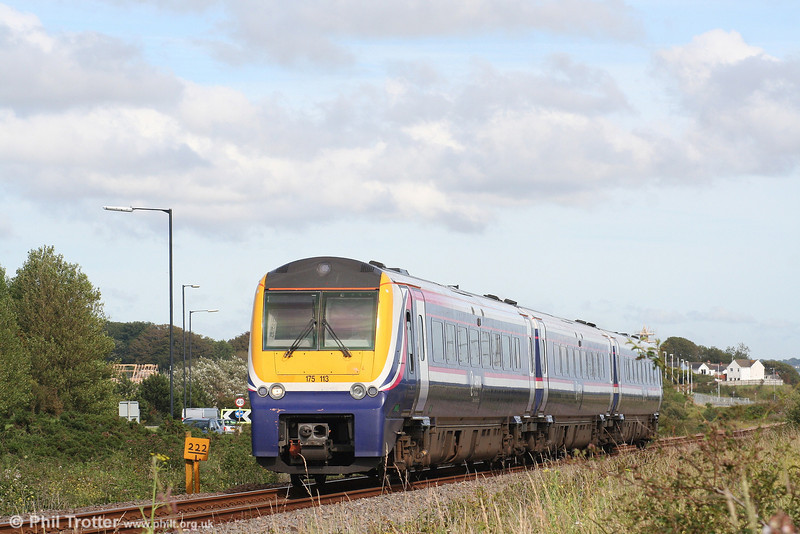 175113 in full sun at Loughor, forming the 1234 Manchester Piccadilly to Milford Haven on 14th July 2007.