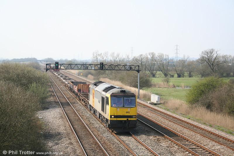 60092 'Reginald Munns' heads an engineering train for Alexandra Dock Junction through Coedkernew on 1st April 2007.