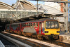 Three-car 144016 in the evening sunshine at Leeds on 2nd May 2007.