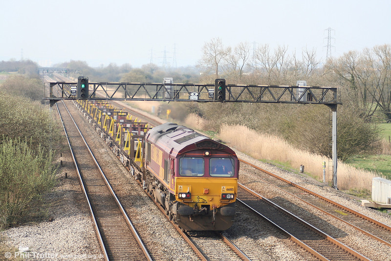 66185 heads 6H25, 0958 Margam - Llanwern steel through Coedkernew on 1st April 2007.