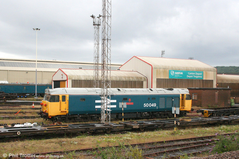 A passing glimpse of the Class 50 Alliance's 50049 'Defiance' being prepared at Cardiff Canton for a light engine move to the West Somerset Railway (0Z50, 1134 Canton TMD to Bishop's Lydeard) on 17th July 2007. The loco was booked to haul the return Minehead to London Victoria 'Cathedrals Express' the following day.