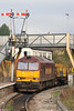 Having run around its train, 60035 departs from Tondu with 6H25, 0849 Margam to Llanwern slabs on 4th November 2007. (And yes, that signal post does lean a bit...).