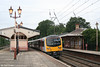 In a view which clearly illustrates Hanwell Station's original Grade 2 listed buildings, 360202 pauses with the 1603 Paddington - Heathrow Airport on 5th July 2007.