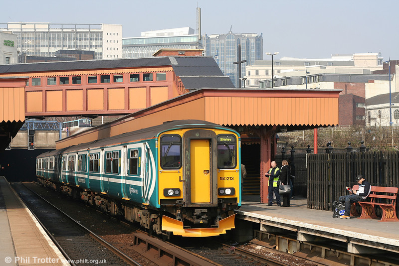 Transferred to Central Trains from Anglia and still carrying that operator's livery, 150213 calls at Birmingham Moor Street with 2S34, the 1126 Kidderminster - Shirley on 28th March 2007.