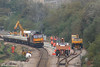 New sleepers are offloaded from flats hauled by Load Haul liveried 60059 'Swinden Dalesman' during track relaying at Briton Ferry on 14th October 2007.