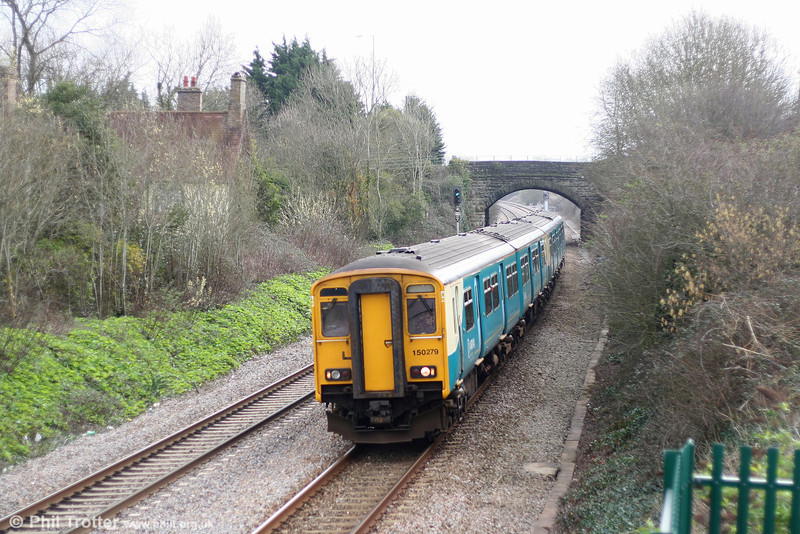 ATW 150279 slows to call at Pyle, forming the 0914 Cardiff to Swansea stopping service on 17th March 2007.