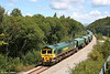 While the crowds flock to the beaches on a perfect summer's day, Freightliner 66531 hauls its loaded JGA aggregate hoppers towards Swansea Burrows Yard, forming 6B75, 1338 Neath Abbey Wharf to Cardiff Pengam at Jersey Marine on 8th August 2007.