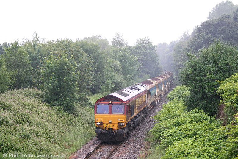 66063 near Neath Abbey with 6W24, 0800 Alexandra Dock Junction to Neath and Brecon Junction ballast working on a very damp Sunday morning, 17th June 2007.