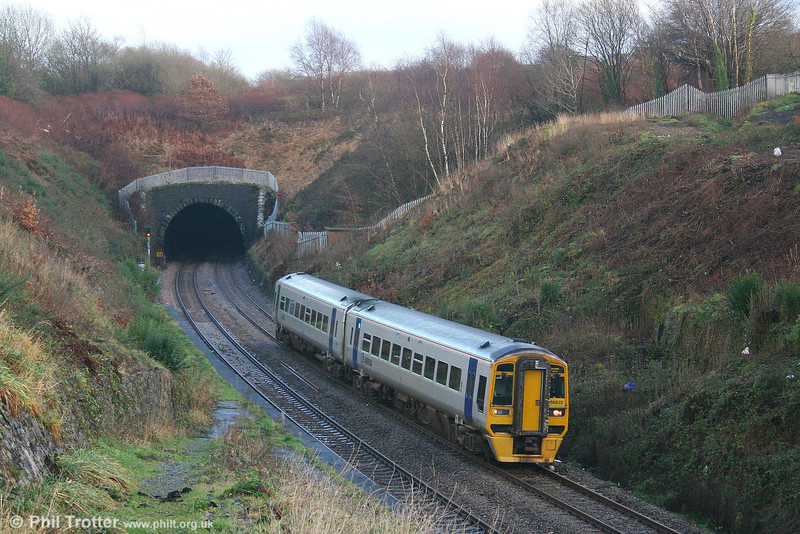 The removal of vegetation has once again opened up a clear view of the former Cockett Station, Swansea. ATW 158835 exits the 788 yds long tunnel with the 1034 Manchester Piccadilly - Milford Haven on 6th January 2007. Cockett Station closed from 15th June, 1964.