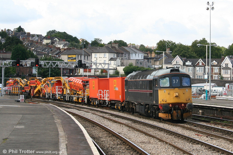 Unusual working of the day on 6th August 2007 was former FM Rail 33202 on a Newport Alexandra Dock Junction to Westbury Yard move. The loco is seen heading its train of Seco-Rail on-track plant through Newport Station.