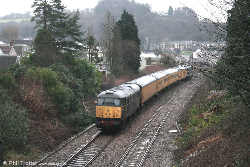 31106 'Spalding Town' passes through Skewen at the rear of the substitute NMT, forming 1Z94, 1501 Swansea to Derby on 26th January 2007.