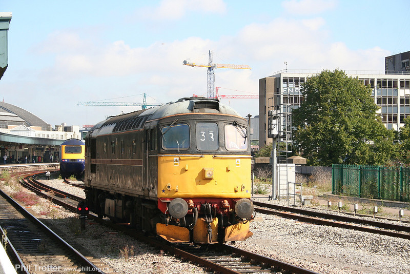 Cotswold's former FM Rail 33202 waits to leave Bristol Temple Meads against a backdrop of construction cranes as 0Z33 on 11th August 2007. The loco was heading for the South Devon Railway for a repaint into BR blue livery.