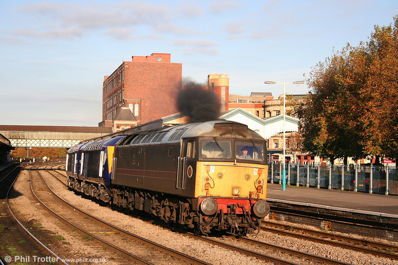 Cotswold's 47703 accelerates through Newport, conveying re-engineered FGW power cars 43192 and 43037 as 5Z45, 1130 Brush, Loughborough to Landore TMD on 2nd November 2007. New in 1967 as D1960, 47703 ('Saint Mungo') became one of the original Scotrail push-pull fitted 47/7s in 1979 and has since served with BR Parcels Sector, Waterman Railways and Fragonset.
