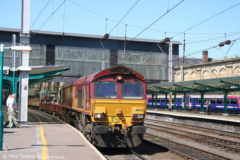 66023 heads south through Carlisle with 6K05, 1330 Carlisle Yard - Crewe departmental. 3rd May 2007.