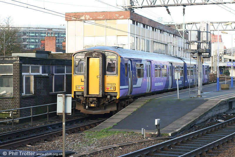 Another reliveried Northern class 150, 150273 at Manchester Piccadilly with the 0704 Buxton - Deansgate on 9th March 2007.