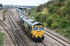 Freightliner 66560 pulls away from Bristol Parkway with 6Z28, Cardiff Pengam to Theale loaded stone hoppers on 1st September 2007. The wagons would have been loaded at Neath Abbey Wharf the previous day.