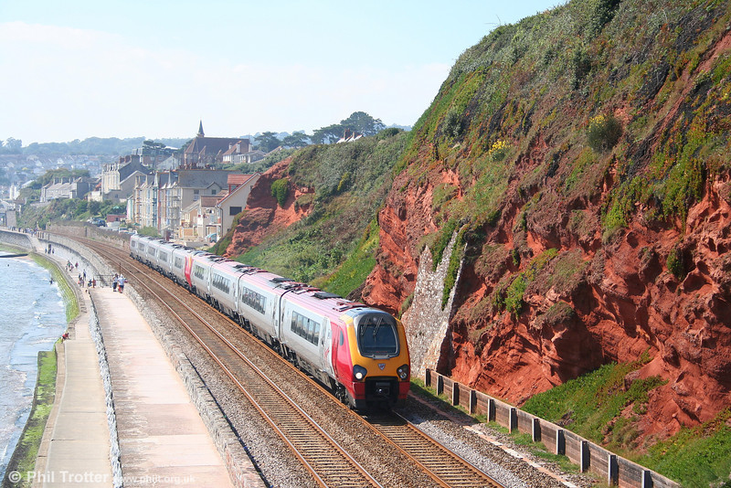 A nine-car Voyager formation comprising 220033 'Fife Voyager' and 221107 'Sir Martin Frobisher' heads along Dawlish sea wall forming the 1230 Paignton to Glasgow Central on 8th September 2007.