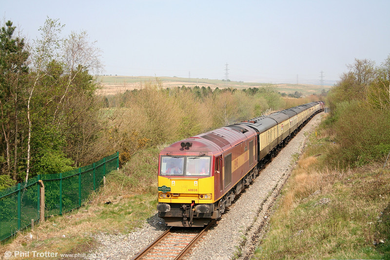 60038 'Avesta Polarit' passes through the site of Seven Sisters station with the 'Principality Freighter' from Onllwyn on 14th April 2007.