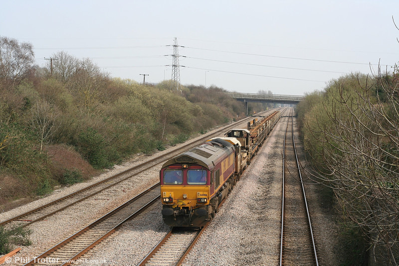 66006 heads for Newport at Llandevenny with a train of new rails on 24th March 2007.
