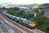 Freightliner 66531 passes Briton Ferry with 6B75, 1338 Neath Abbey Wharf to Cardiff Pengam on 8th August 2007.