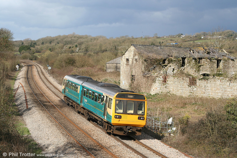 The abandoned farm at Llangewydd continues to provide an interesting backdrop, even when the train ain't up to much. Storm clouds gather as 142081 passes by forming the 1110 stopping service from Swansea to Cardiff on 29th March 2007.