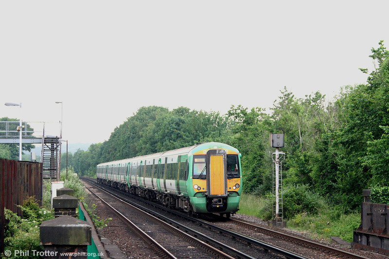 A thunderstorm threatens as Southern 377307 approaches Purley with the 1449 Brighton - London Victoria on 9th June 2007. The 377/3s were originally classified 375, but renumbered when fitted with a revised coupling arrangement. These are 750V DC only.