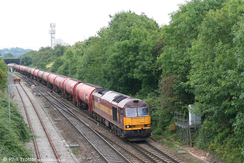60048 'Eastern' near Bristol Parkway with 6B33, 1214 Theale to Margam empty Murco bogie tanks on 1st September 2007.