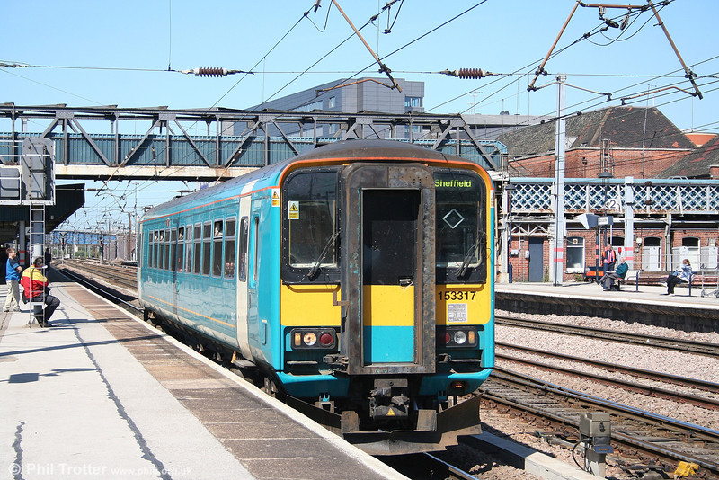 Still in Arriva livery, Northern's 153317 leaves Doncaster with a stopping service for Sheffield on 30th April 2007.