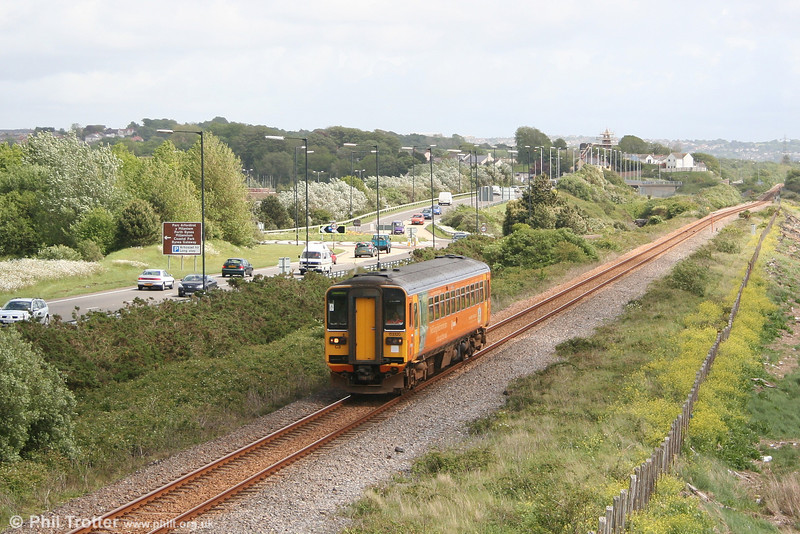 153320 cuts a lonely figure at Loughor, forming the 1405 Swansea - Pembroke Dock on 19th May 2007.