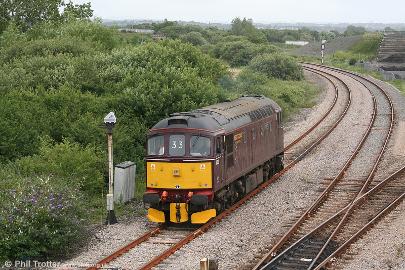 33207 'Jim Martin' awaits clearance to cross over the main lines from the Up District Line at Llandeilo Junction on 2nd July 2007. The former D6592 previously carried the name 'Earl Mountbatten of Burma'.