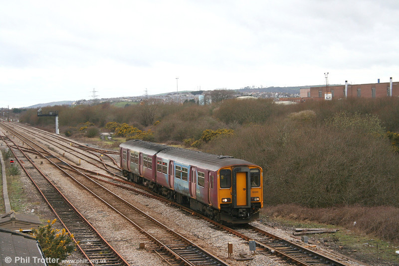 Former FGW 150230 passes Llandeilo Junction with the 1305 Tenby - Swansea service on 25th February 2007.