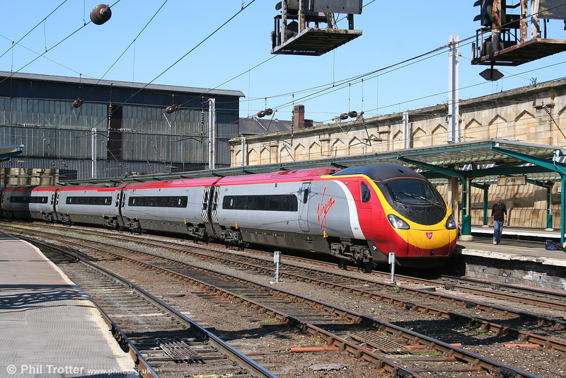 VWC 'Pendolino' 390006 'Virgin Sun' leaves Carlisle with the 1249 Glasgow to London Euston on 3rd May 2007. 390006 will call next at Preston and then run non-stop to Euston.