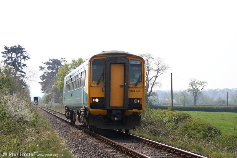 153323 returns north through Glanrhyd as the 1317 Swansea - Shrewsbury on 21st April 2007.
