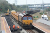 66020 delivers fresh ballast to the work site during relaying of the Up Main at Briton Ferry on 14th October 2007. 66034 waits in the background with another load (top right).