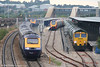 A busy scene at Bristol Parkway on 1st September 2007. FGW's 1430 Swansea to London Paddington is nearest the camera, with the 1445 Paddington to Swansea in the background. To the right, platform 4 is occupied by VXC's 1410 Paignton to Manchester Piccadilly while Freightliner 66560 waits in the loop to proceed with 6Z28, Cardiff Pengam to Theale loaded stone hoppers.