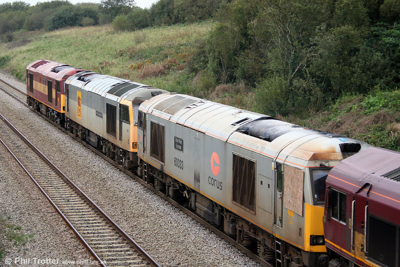 60033 'Tees Steel Express' (in Corus silver livery), 60067 'James Clerk-Maxwell' and 60037 'Aberddawan/Aberthaw' in transit from Margam to Toton at Stormy Bank on 24th September 2008. Nice bit of plywood...