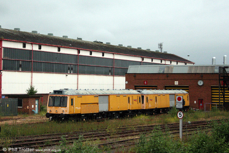 Following a spell in store at Long Marston, the two former class 121 'bubble cars' which were converted for use as Severn Tunnel Emergency Trains have returned to Cardiff Canton as a source of spares for ATW's own unit. The pair, with 960303 (former 55031) nearest the camera and 960302 (former 55027) behind are seen at Canton on 21st June 2008.