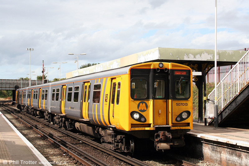 507013 at Birkenhead North forming the 1423 New Brighton to Liverpool on 1st September 2008.