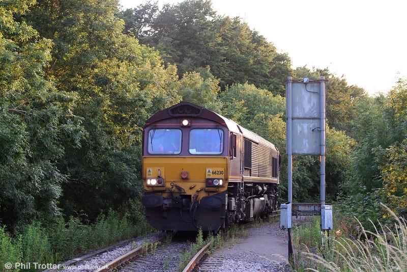 66230 waits to cross the A48 at Waterton, Bridgend, running as 0B46, 1859 Newport ADJ to Bridgend Ford Sidings on 16th June 2008.