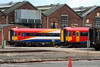 'Plastic Pig' class 442 units 2423 and 2403 in store at Eastleigh on 23rd August 2008. 2403 carries the later, revised SWT livery.