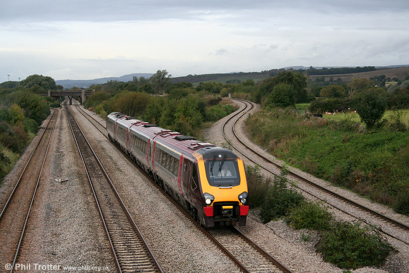 Diverted XC class 220 no. 220016 shows off the latest livery variation as it passes Llandevenny on 4th October 2008.