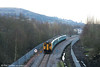 A sheep stands back in amazement as 150208 & 150262 leave Ebbw Vale forming the 1640 departure for Cardiff Central (continuing to Bridgend) on 9th February 2008.