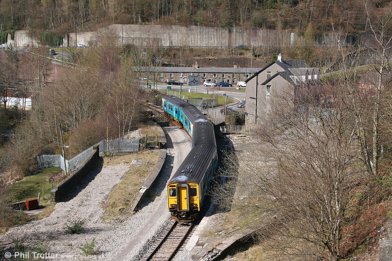 Units 150284 and 150252 pass through the remains of Aberbeeg station with the 1235 Cardiff Central to Ebbw Vale on 22nd March 2008. The line to Abertillery and Nantyglo formerly branched off to the right and served a separate platform.