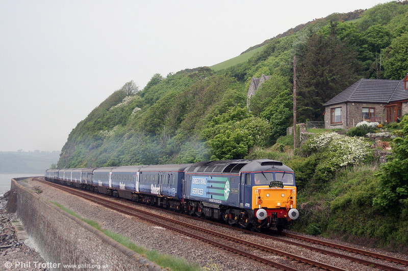 DRS 47712, currently named 'Pride of Carlisle' heads along the sea wall at St. Ishmaels with 1Z37, 1614 Carmarthen to London Paddington 'The Stobart Pullman' on 15th May 2008. 47712's previous identities have included such diverse personalities as 'Prince Charles Edward', 'Lady Diana Spencer', 'Dick Whittington', 'Sir Jimmy Saville' and 'Artemis'! (Published in The Railway Herald, 16th May 2008).