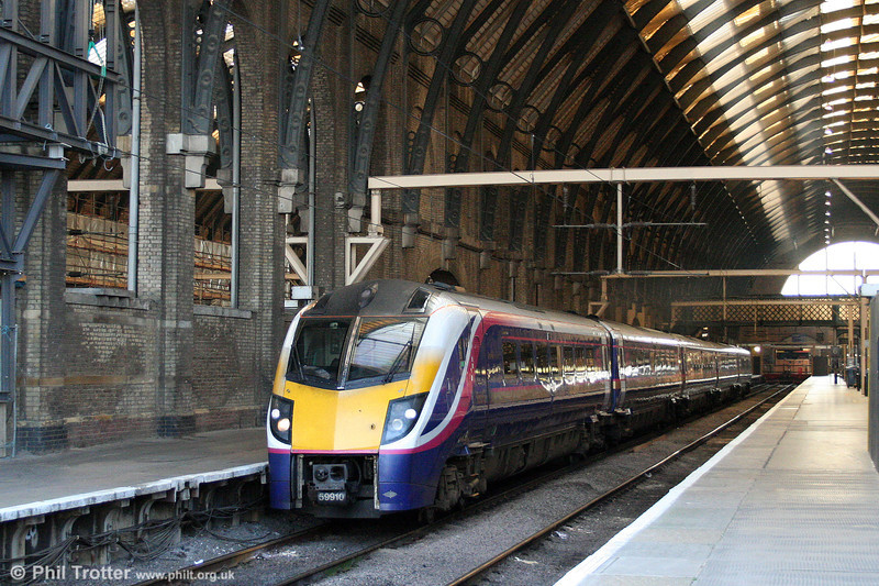 Stranger in the camp... Former FGW 180110, now with Hull Trains, departs from London King's Cross forming the 1148 service to Hull on 20th September 2008.