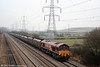 66129 is dwarfed by electricity pylons as it passes Duffryn with 6F66, 0630 Newport Docks to Aberthaw on 30th December 2008.