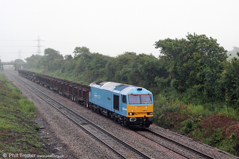 Adding a little colour to an otherwise grim evening, 60074 'Teenage Spirit' heads down Stormy Bank in the drizzle with 6V92, 1010 Corby to Margam steel empties on 27th June 2008.