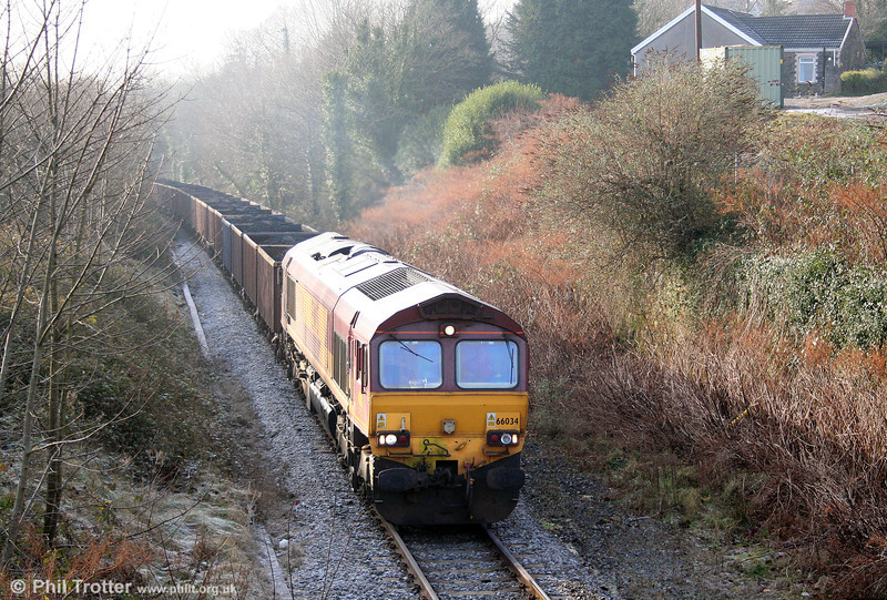66034 heads through Neath Abbey with 6F76, 1013 Parc Slip to Onllwyn on 31st December 2008. In the event, 66034 failed at Blaenant and the train returned to Burrows Yard behind 66013 which was summoned from Margam to assist.