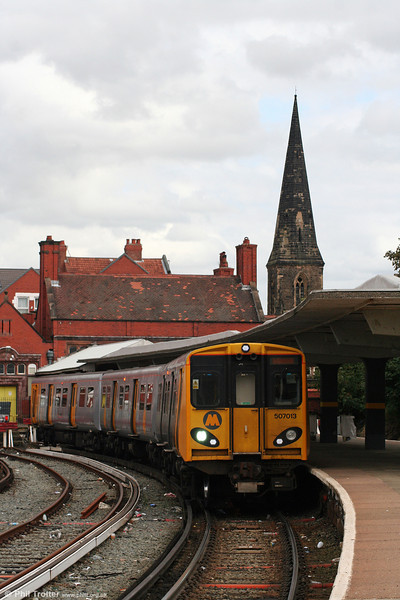 The spire of St. James's Church, New Brighton forms a backdrop to MR 507013 as it prepares to leave the terminus forming the 1423 service back to Liverpool on 1st September 2008.